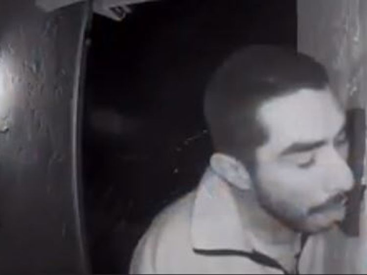 Roberto Daniel Arroyo was caught on CCTV licking a doorbell for three hours. Pic