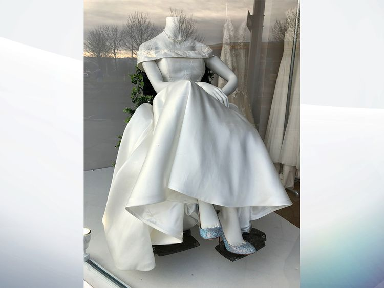 The dress worn by the mannequin posed in a wheelchair