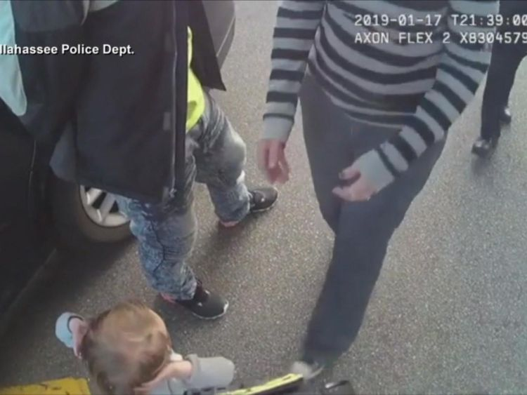 Video of child walking with hands up to police goes viral