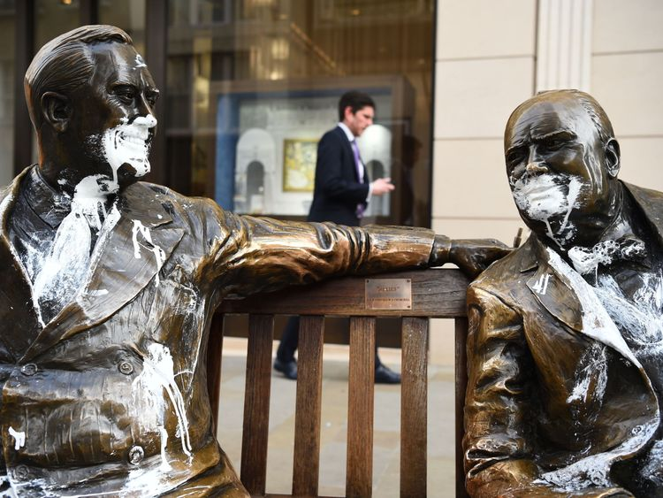 A statue of Franklin D. Roosevelt and Sir Winston Churchill, right, was also vandalised