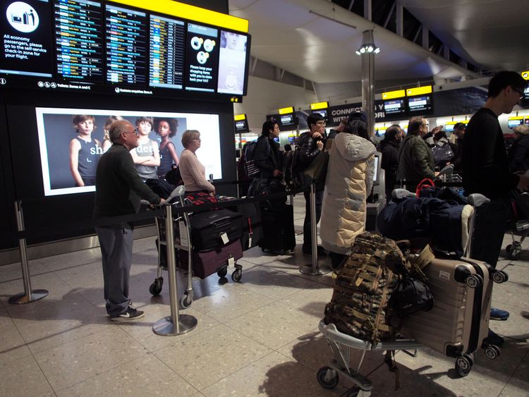 Passengers in Terminal 2 at Heathrow airport after departures were temporarily suspended