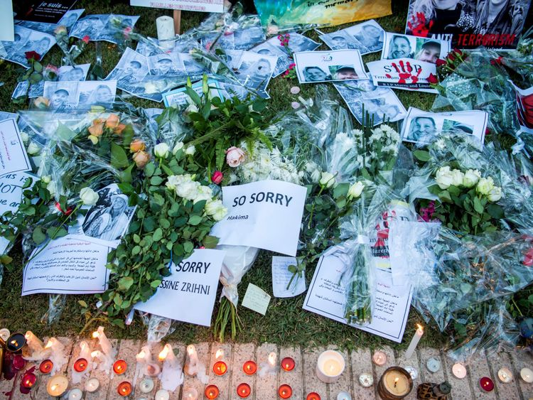 This photo shows texts, photos and candles arranged as Moroccans pay homage to the Danish killed Louisa Vesterager Jespersen and the Norwegian Maren Ueland in Rabat, in front of the Norwegian Embassy on 22 December 2018