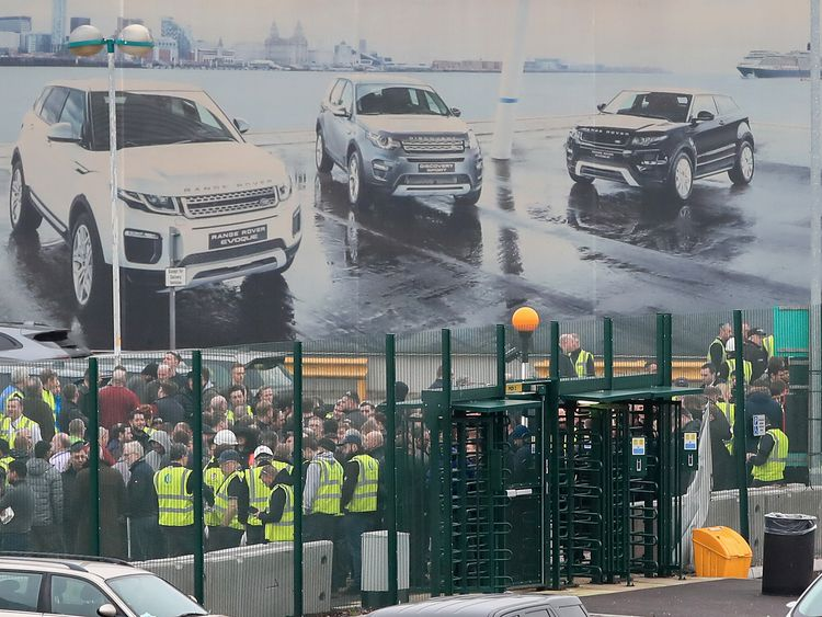 Staff gather outside the Jaguar Land Rover site in Halewood Knowsley Merseyside
