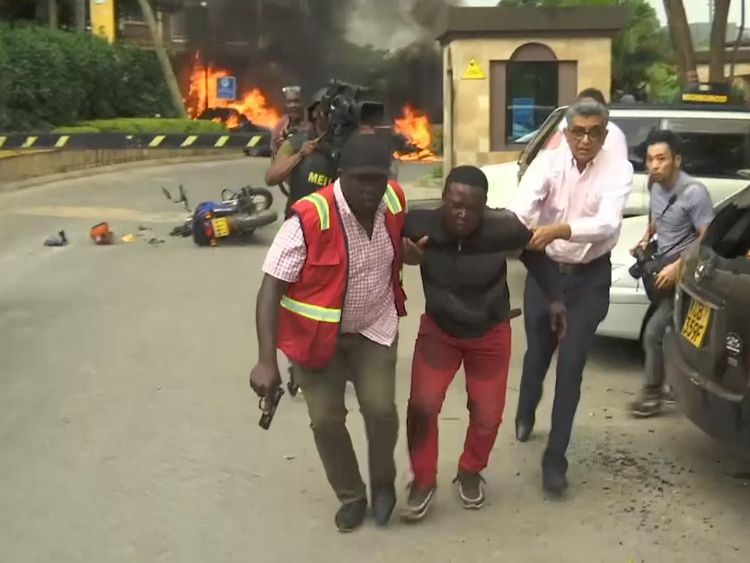 People are being rushed away from the scene in Nairobi