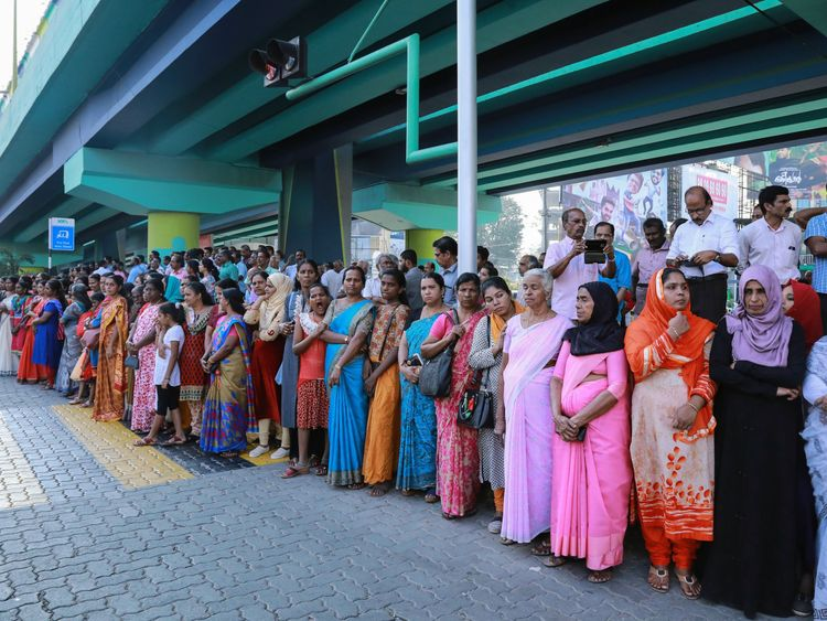 Women form part of the 385-mile line in the city of Kochi in Kerala