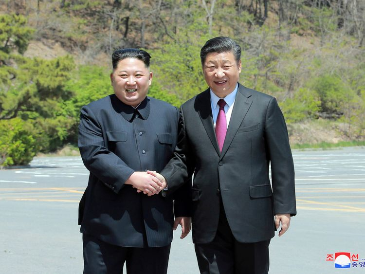 North Korean leader Kim Jong Un shakes hands with China's President Xi Jinping in Dalian China in this undated