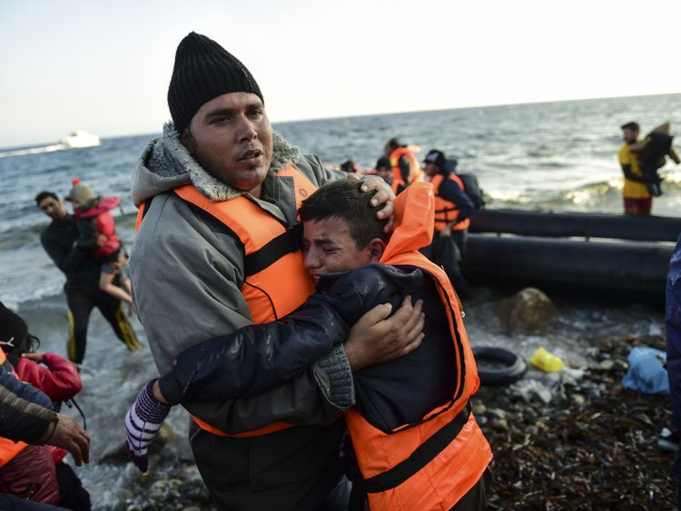 People reach the Greek island of Lesbos in 2015