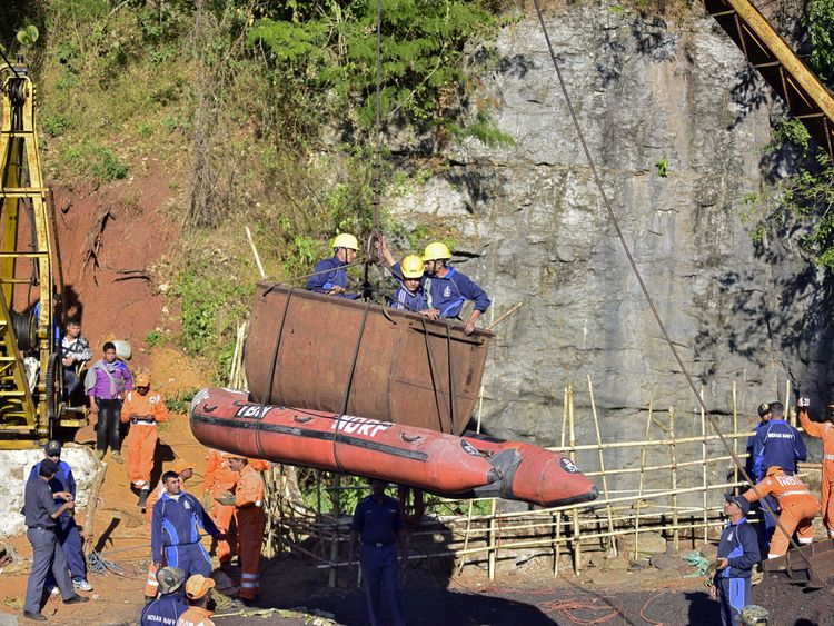 Indian navy personnel emerge from the mine in Meghalaya
