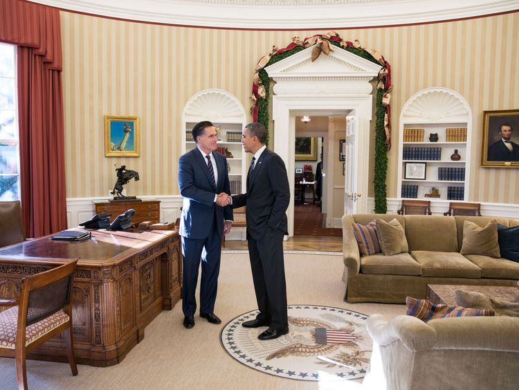 WASHINGTON - NOVEMBER 29: In this handout from the White House, Former Republican presidential candiate and Massachusetts Gov. Mitt Romney (L) shakes hands with U.S. President Barack Obama in the Oval Office following their lunch November 29, 2012 in Washington, DC . Obama had invited Romney to the White House for the lunch. (Photo by Pete Souza/White House Photo via Getty Images)