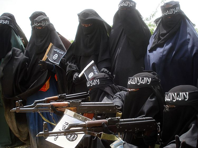 Somali women carry weapons during a demonstration organized by the islamist Al-Shabaab group which is fighting the Somali government in Suqa Holaha neighborhood of Mogadishu, on July 5, 2010