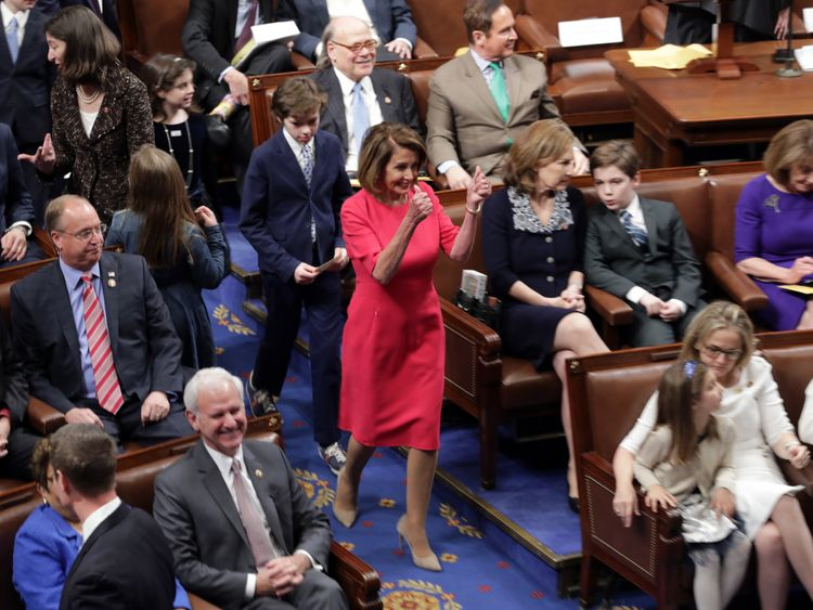 Speaker-designate Rep. Nancy Pelosi (D-CA) gives a double thumbs up on her way into the chamber