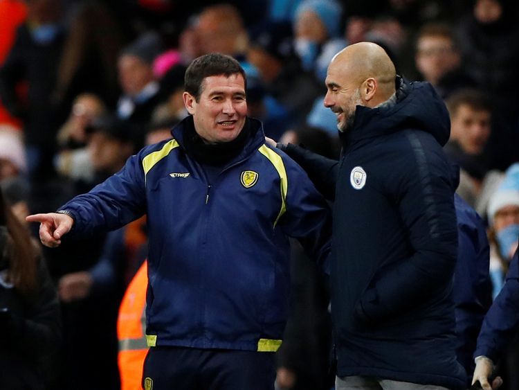 Manchester City manager Pep Guardiola and Burton Albion coach Nigel Clough