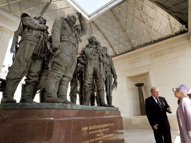 Queen Elizabeth II unveils the Bomber Command Memorial in Green Park, London, watched by the Duke of Edinburgh