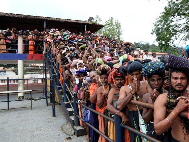 Men queue to entered the Sabarimala shrine which sits at the top of a four-hour uphill trek