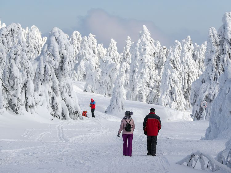 Hikers tackle the snow covered Fichtelberg mountain ski resort