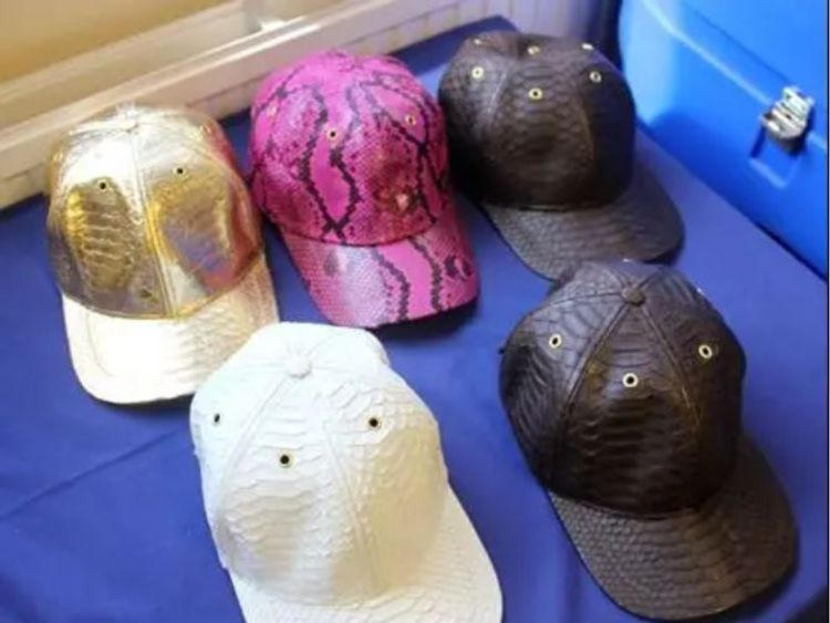The python-skin hats were being sold online and in three London stores. Pic: Met Police