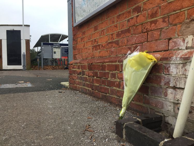 Flowers left at Horsley station near Guildford, Surrey