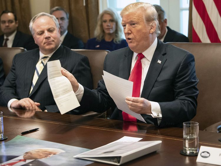 Donald Trump shows a letter he said was from North Korean leader Kim Jong-un during a Cabinet meeting