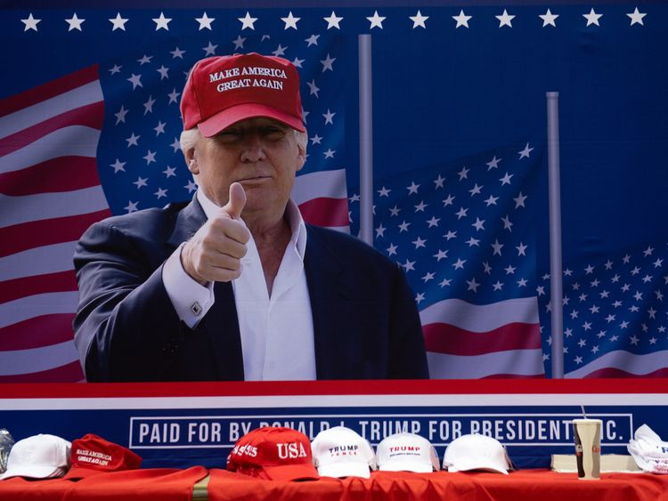 Donald Trump wearing one of his MAGA hats at a campaign rally