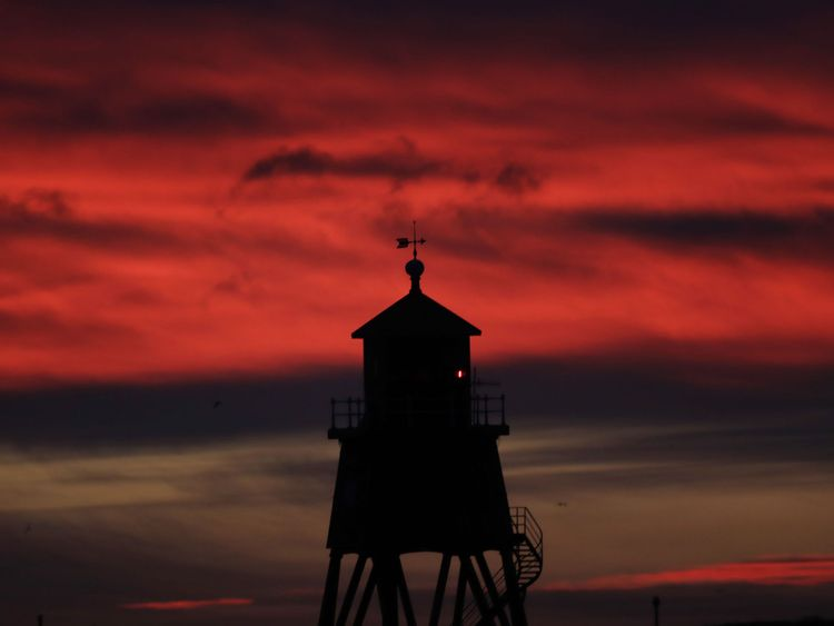 Sunrise over the Herd Groyne Lighthouse in South Shields