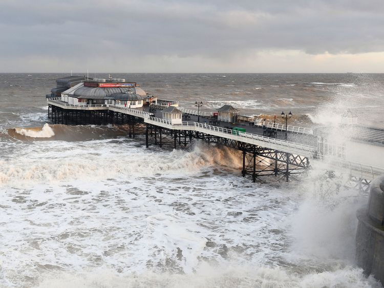 Waves crash around Cromer Pier in Norfolk