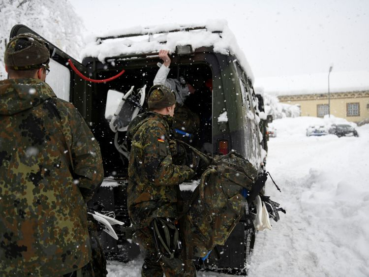 German soldiers are drafted in to clear snow in Berchtesgaden