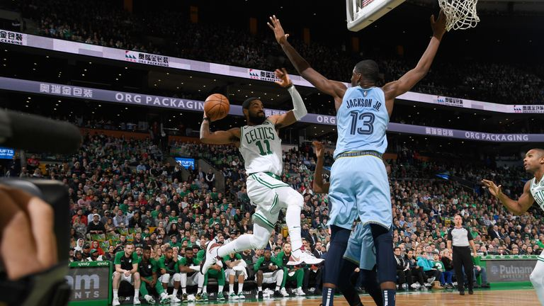 Kyrie Irving attacks the basket against Memphis