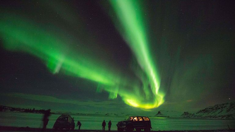 Tourists photograph the Northern Lights