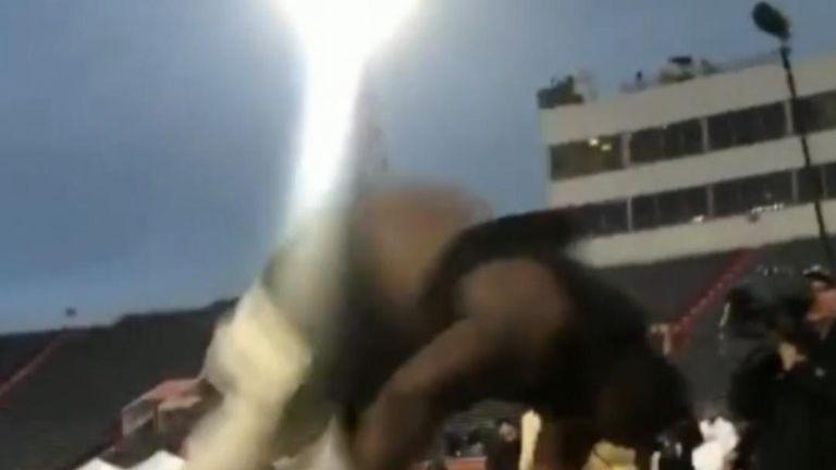 American footballer performs backflip