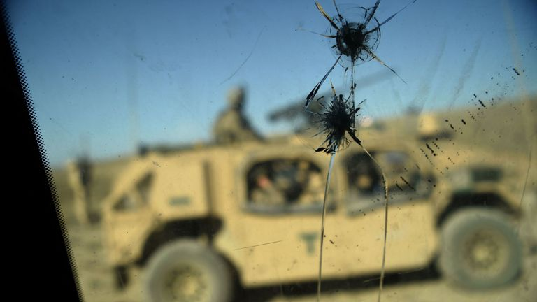 US Army soldiers seen through a cracked window of an armed vehicle in a checkpoint