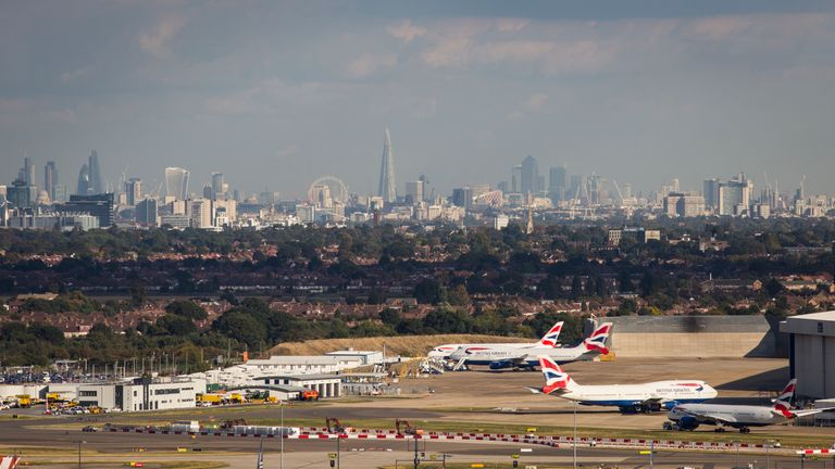 LONDON, ENGLAND - OCTOBER 11: A general view of aircraft at Heathrow Airport in front of the London skyline on October 11, 2016 in London, England. The UK government has said it will announce a decision on airport expansion soon. Proposals include either a third runway at Heathrow, an extension of a runway at the airport or a new runway at Gatwick Airport. (Photo by Jack Taylor/Getty Images)