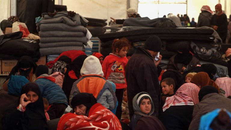 Displaced Syrians gather inside a tent in the Internallly Displaced Persons (IDP) camp of al-Hol in al-Hasakeh governorate in northeastern Syria on December 8, 2018