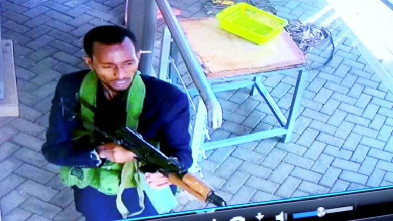 A gunman is pictured as he and others make their way into a hotel and office complex in Nairobi, Kenya, January 15, 2019, in this still image taken from a CCTV footage obtained by Reuters TV Janaury 16, 2019. REUTERS/Reuters TV NO RESALES. NO ARCHIVES. FOR REUTERS CUSTOMERS ONLY