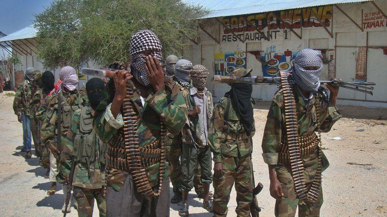 Al-Qaeda linked al-shabaab recruits walk down a street on March 5, 2012 in the Deniile district of Somalian capital, Mogadishu, following their graduation