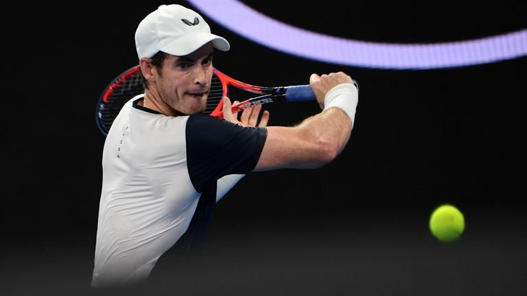 Britain's Andy Murray plays a backhand return during his men's singles match against Spain's Roberto Bautista Agut on day one of the Australian Open tennis tournament in Melbourne on January 14, 2019