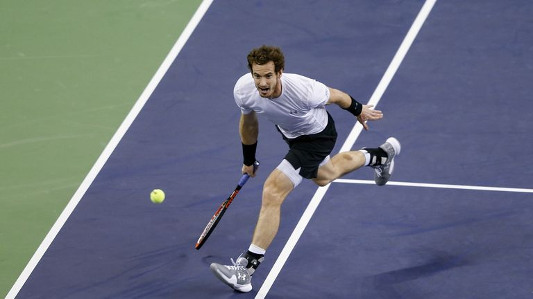 Andy Murray of Great Britain returns a shot against Novak Djokovic of Serbia during the men's singles semifinal match on day 7 of Shanghai Rolex Masters at Qi Zhong Tennis Centre on October 17, 2015 in Shanghai, China