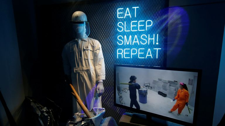 A sign reads eat, sleep, smash, repeat at the anger rooms