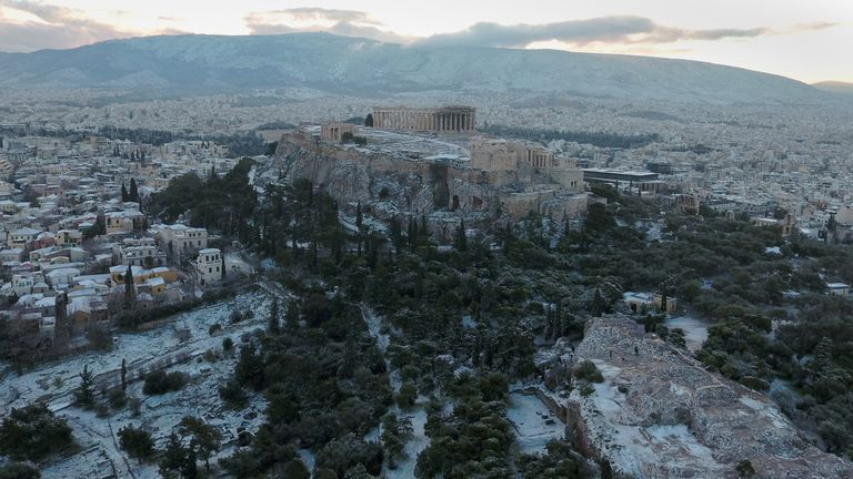 The Parthenon temple atop the Acropolis after snow fell in Athens