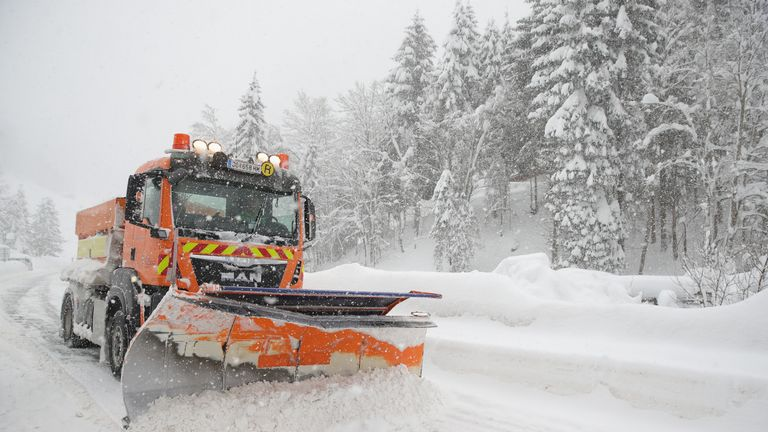 A snow plow cleans the main road out of a valley that was blocked after heavy snow falls on January 5, 2019 in Filzmoos, Austria