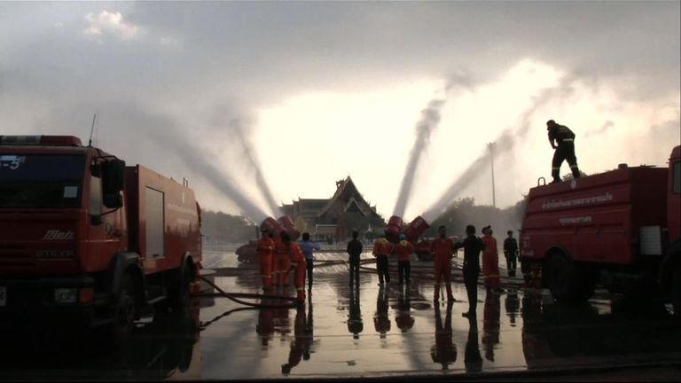 The government is using water cannons to try to dissipate the dust