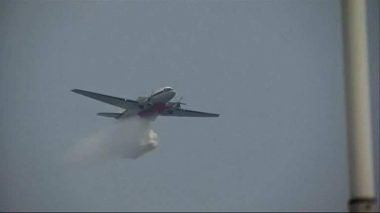 Planes are being used to distribute chemicals which will trigger rain to clear the pollution