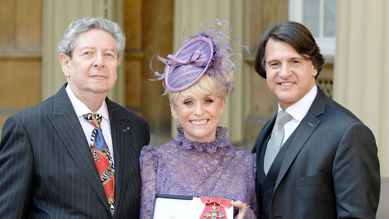 Barbara Windsor with husband Scott Mitchell (right) and agent Barry Burnett after being made a Dame Commander of the Order of the British Empire by Queen Elizabeth II at Buckingham Palace in 2016, for services to charity and entertainment