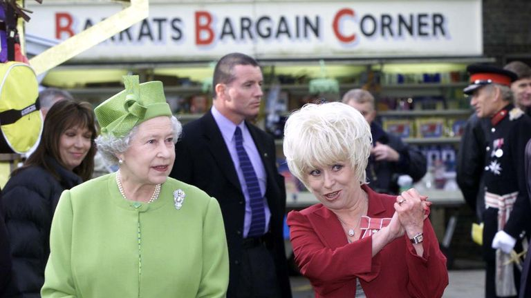Queen Elizabeth II and Barbara Windsor during visit to Elstree Studios where EastEnders was filmed, in 2001
