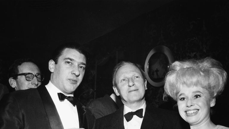 Actress Barbara Windsor with notorious East End gangster Ronnie Kray (left), London, circa 1960