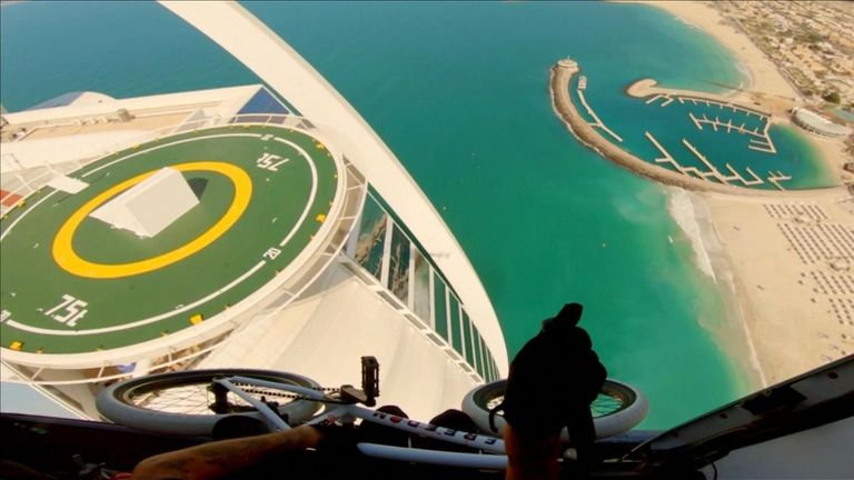 BMX biker Kriss Kyle leaped out of a helicopter and onto the helipad of the iconic Burj al Arab hotel.