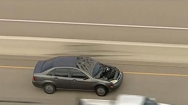 Suspected bank robbers getaway hampered by flipping car bonnet in Dallas