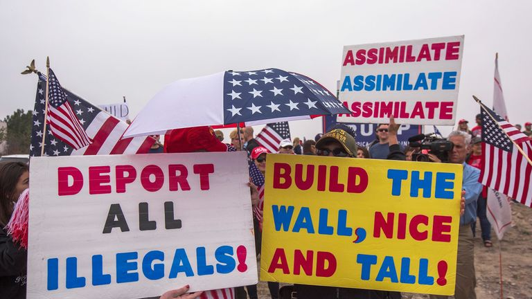 Supporters of Trump rally at the wall during his visit to California