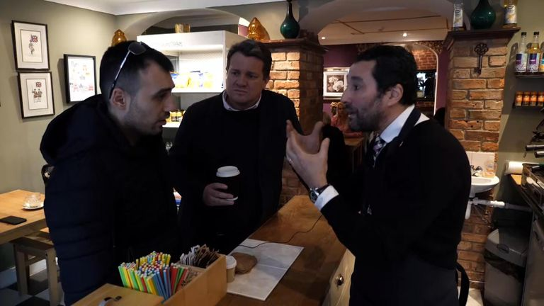 Cafe owner Anton Dani (R) debates Brexit with customer Vladislav Markov (L)