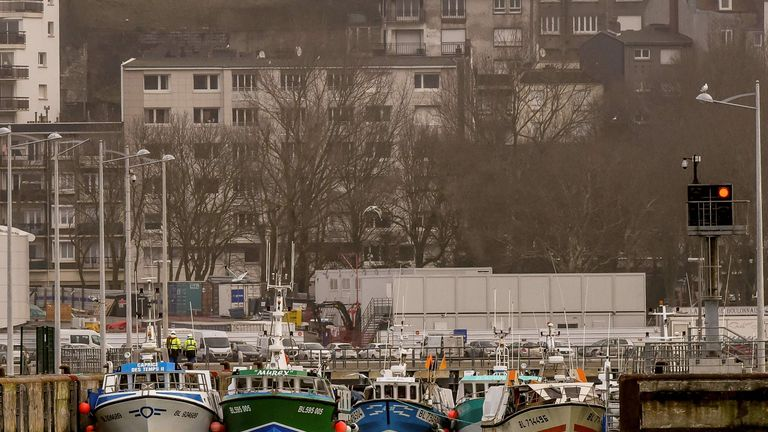 Fishing boats block the access to the harbour of Boulogne-sur-Mer on January 25, 2018 as they protest against electric pulse fishing practiced by fishermen from Netherlands. French fishermen blocked the port of Calais, preventing cross-Channel ferries arriving or departing, and a road leading to the port of Boulogne-sur-Mer, about 30 kilometres (20 miles) southwest of Calais, to demand a ban on electric pulse fishing in the North Sea. Pulse fishing involves dragging electrically-charged lines ju