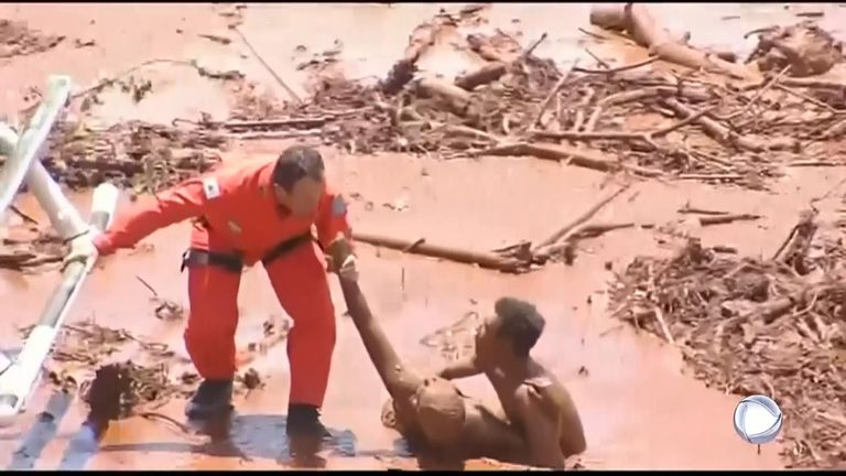 Three men are rescued from the mud after the dam collapsed